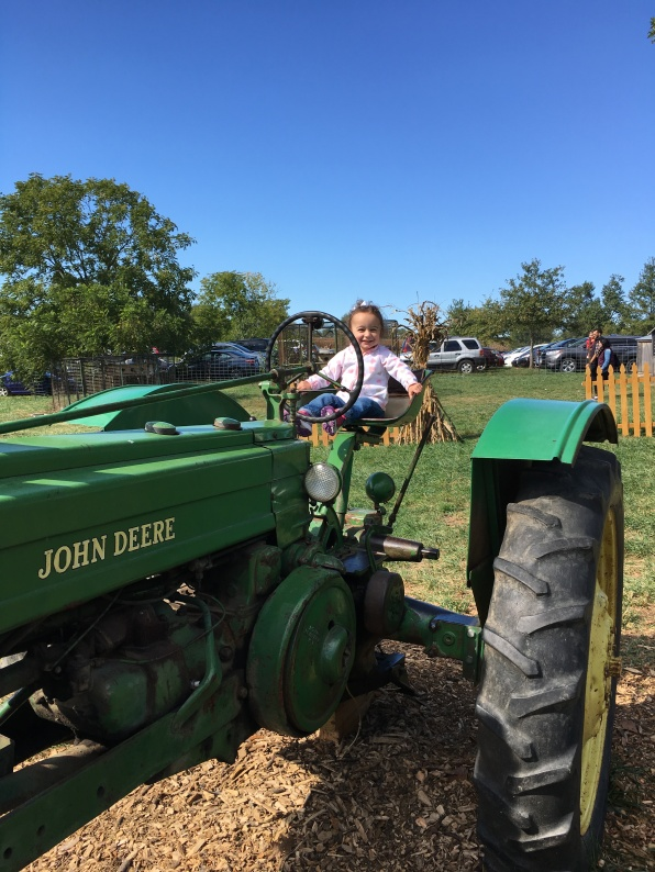 CBUS Dads blogger Steven Michalovich's daughter on a tractor at Pigeon Roost Farm.