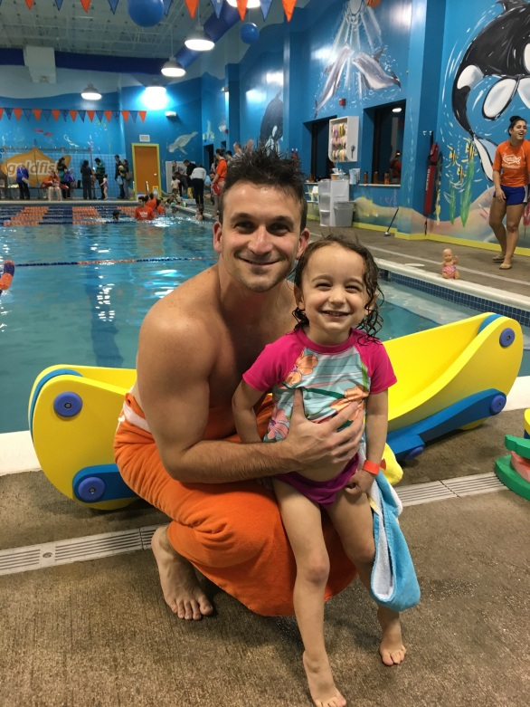 CBUS Dads dad blogger Steven Michalovich and his daughter pose for a picture after their first swim lesson at Goldfish Swim School in Westerville.