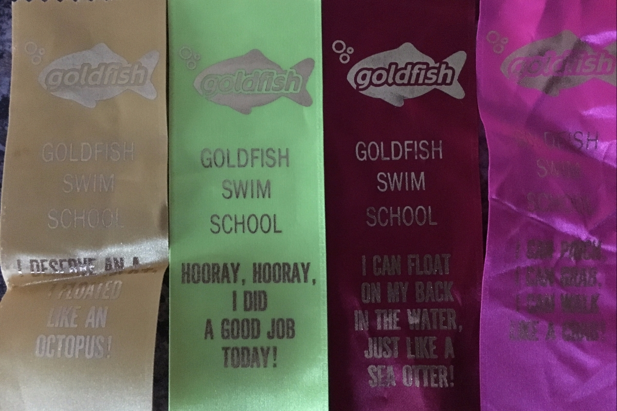 Ribbons CBUS Dads dad blogger Steve Michalovich's daughter earned through three months of swim lessons at Goldfish Swim School in Westerville.