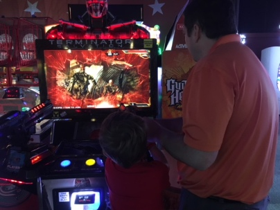 CBUS Dads dad blogger Dan Farkas enjoying the wide array of arcade games at Star Lanes Polaris with his kids