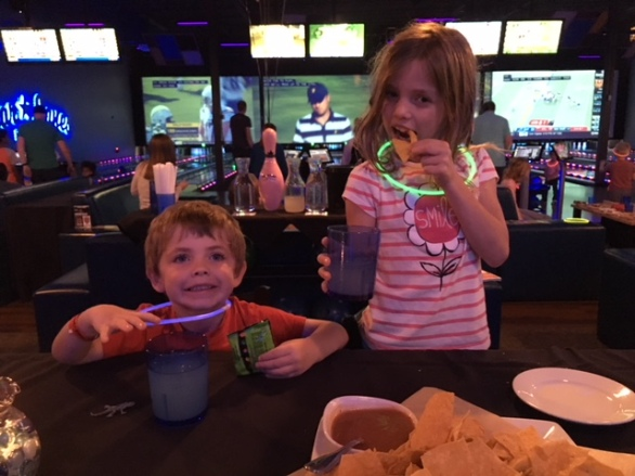 CBUS Dads dad blogger Dan Farkas' kids enjoying some of the quality food options at Star Lanes Polaris