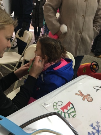 CBUS Dads dad blogger Steve Michalovich's daughter getting her face painted at Christmas in Springboro