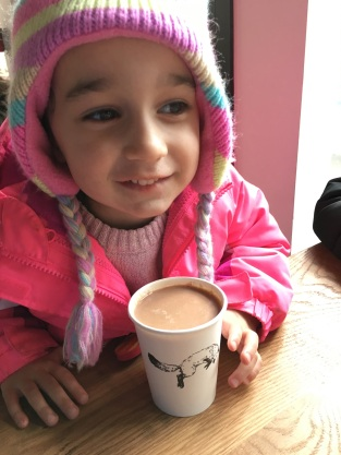 CBUS Dads dad blogger Steve Michalovich's daughter enjoying her hot beverage from Fox in the Snow in German Village