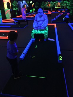CBUS Dads dad blogger Kevin Gerber's son at Glow Putt Mini Golf in Gahanna